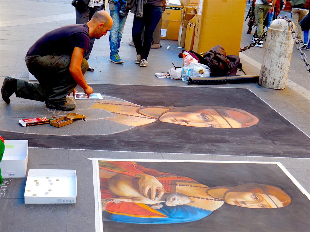 Rom mit Kind Straßenkünstler